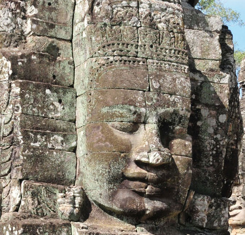 Steinerne Gesichter am Bayon Tempel in Angkor in Kambodscha